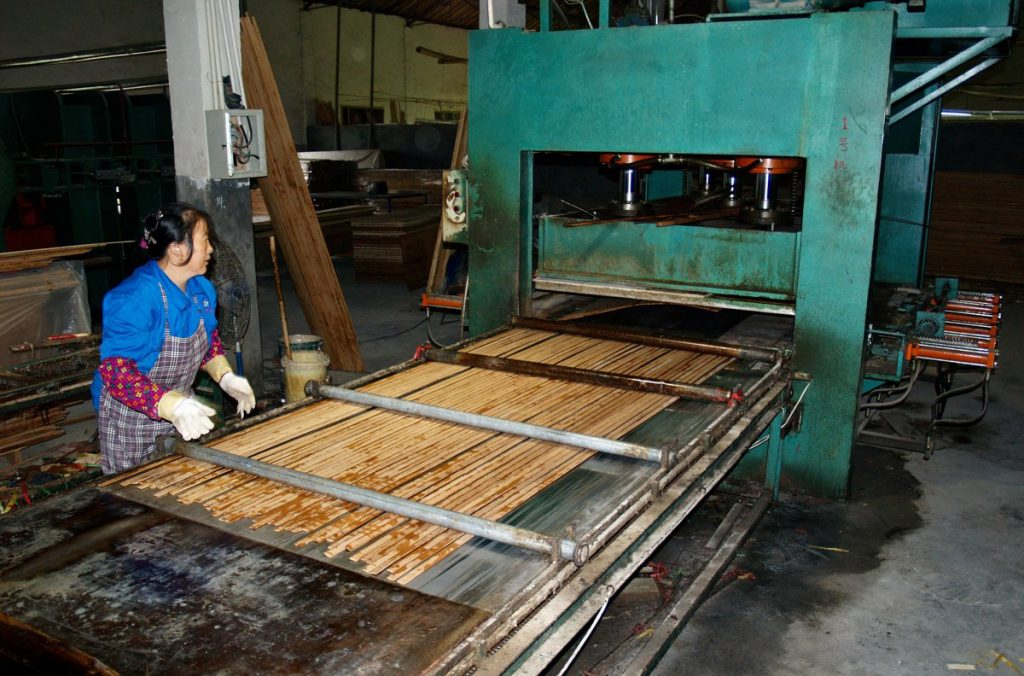 bamboo panel production step 6 pressing bamboo bars into sheets